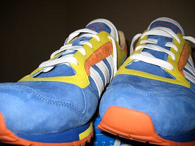 Blue, yellow, and orange sneakers with white laces