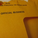 "Envelope with ""OFFICIAL BUSINESS\"" printed on it."
