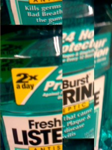 Listerine bottle with label reading 24 hour protection 2x a day. image is segmented.