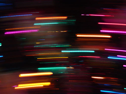 motion blur creating streaks of colorful lights