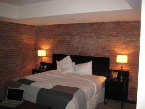 bed and brick wall