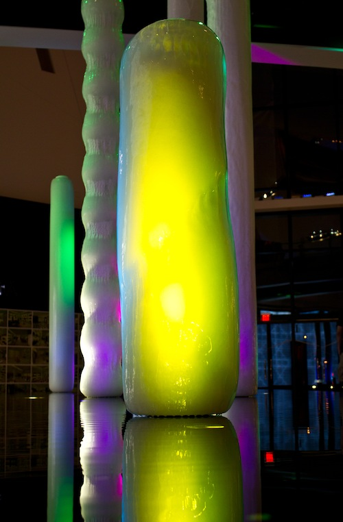poles covered in ice with colored lights shining on them