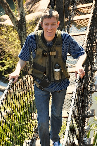 Michael Wyszomierski crossing a rope bridge