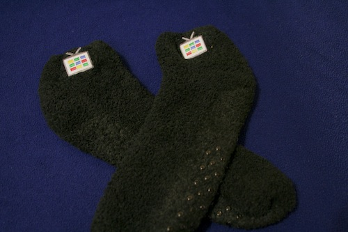 black slipper socks with Google TV logo