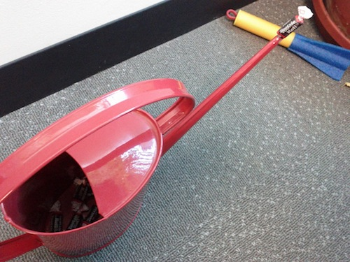 Tootsie Rolls in a red watering can