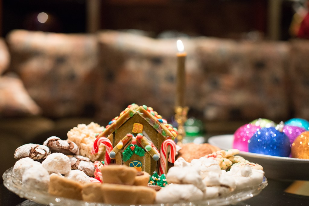 platter of Christmas cookies with a gingerbread house