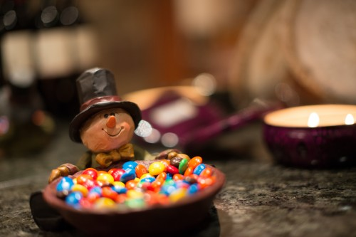 Snowman holding a bowl of M&Ms