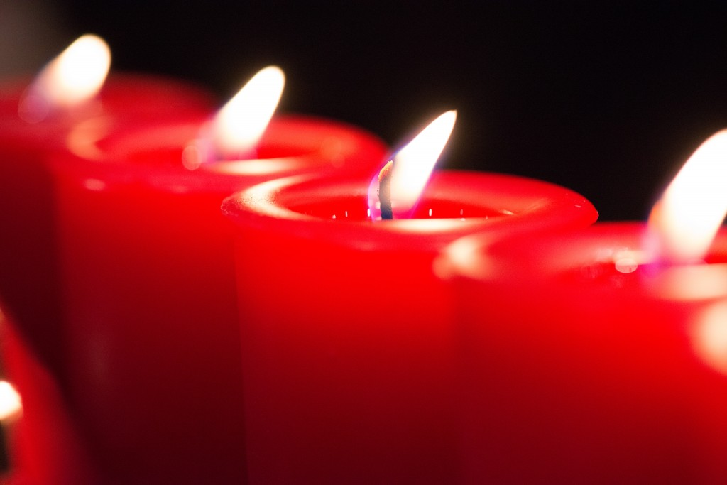 macro of lit red candles