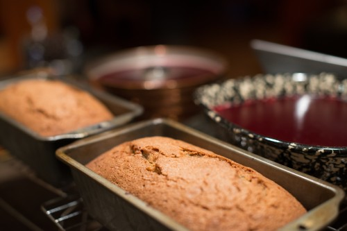 Zucchini bread with cranberry sauce in the background