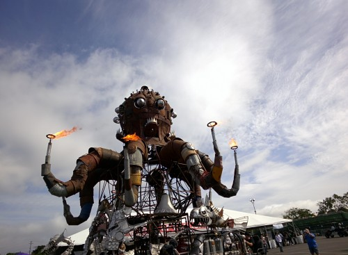 Metal octopus sculpture with fire coming out of the tips of the tentacles